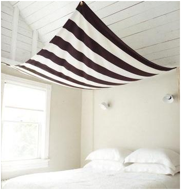 A sail-like canopy in a bedroom